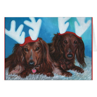 Carte de Noël de paires de Doxie de teckel