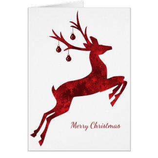 Carte de Noël de renne de concepteur en rouge