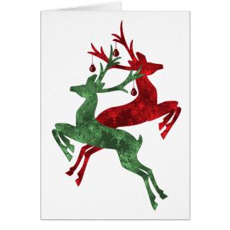Carte de Noël de renne de concepteur en rouge et