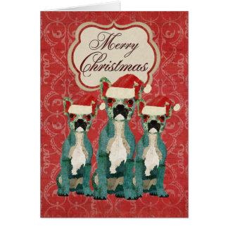 Carte de Noël de trois bouledogues français