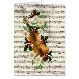 Carte de Noël de violon sur la feuille de musique