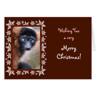 Carte de Noël rouge de lémur de Ruffed