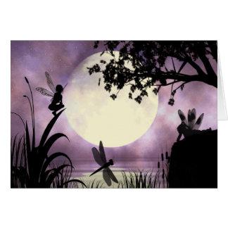 Carte de note éclairée par la lune féerique