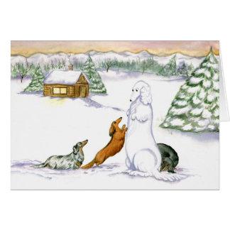 Carte de vacances de teckel de neige