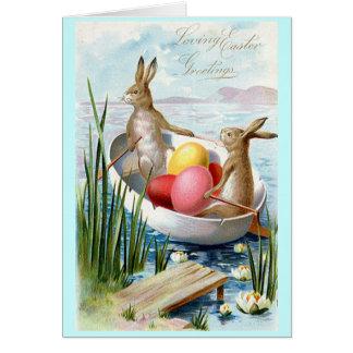 Carte de voeux de bateau à rames de lapins de