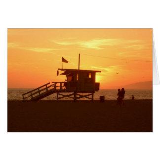 Carte de voeux de coucher du soleil de station de