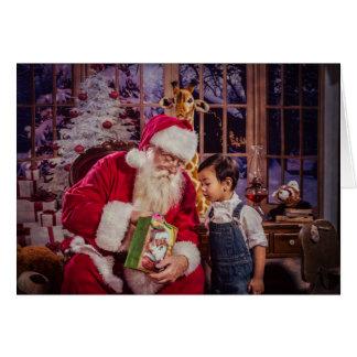 Carte de voeux de Noël avec Père Noël et le garçon
