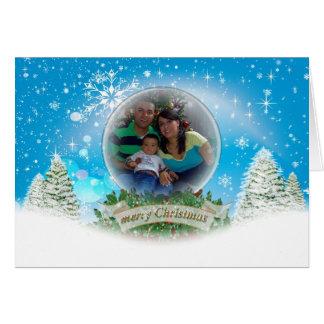 Carte de voeux de Noël de photo de globe de neige