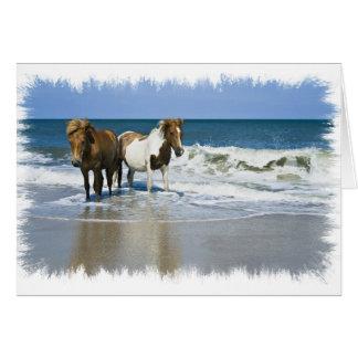 Carte de voeux de plage de cheval