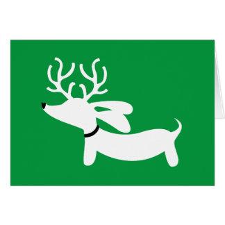 Carte de voeux de vacances de teckel de renne