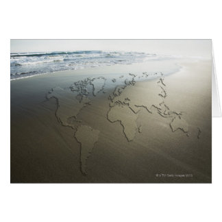 Carte du monde sur le sable