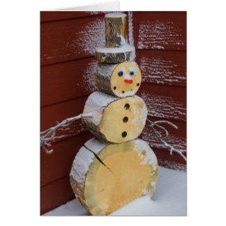 Carte en bois de vacances de bonhomme de neige