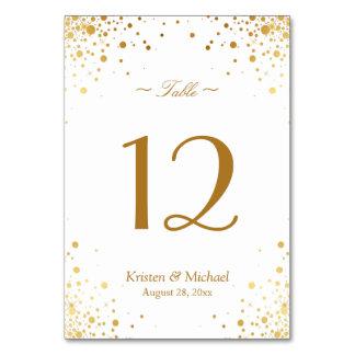 Carte Les confettis élégants d'or pointillent le nombre