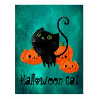 Carte Postale Chat mignon de Halloween avec des citrouilles