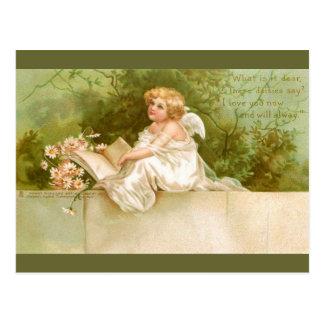Carte Postale Clapsaddle : Ange avec le livre et les fleurs