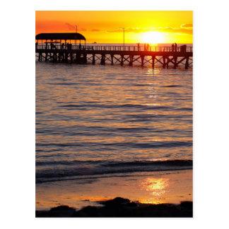 Carte Postale Coucher du soleil à la plage de grange et à la