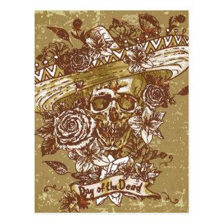 Carte Postale Crâne dans le sombrero avec le jour de fleurs des