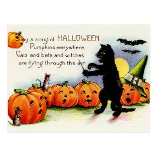 Carte postale de chat noir, citrouilles de chant,