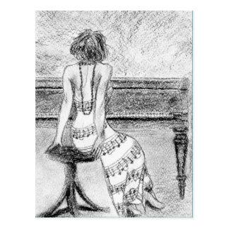 Carte postale de femme à un piano