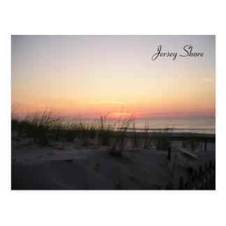 Carte postale de lever de soleil de rivage du