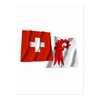 Carte Postale Drapeaux de ondulation de la Suisse et de