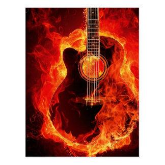 Carte Postale La guitare brûlante, orange flambe le groupe de