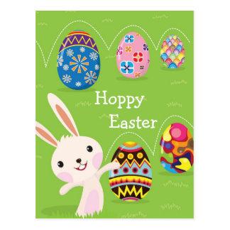Carte Postale Lapin de Pâques espiègle avec les oeufs peints