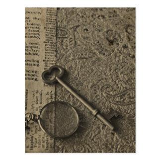 Carte Postale Monocle et clé