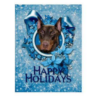 Carte Postale Noël - flocon de neige bleu - dobermann - rocheux