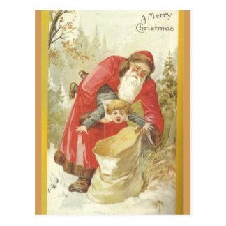 Carte Postale Père Noël bourrant le garçon vilain dans un sac
