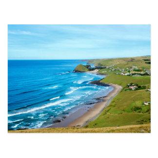 Carte Postale Une vue de trou dans le mur sur la côte sauvage