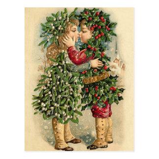 Carte Postale Vieux enfants de houx de mode embrassant Noël