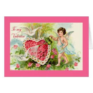 Carte rose de roses de Valentine de cupidon