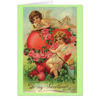 Carte vintage de Valentine avec des cupidons