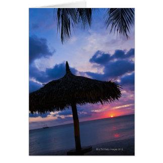 Cartes Aruba, silhouette de palapa sur la plage au