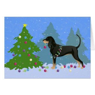 Cartes Coonhound noir et bronzage décorant l'arbre de