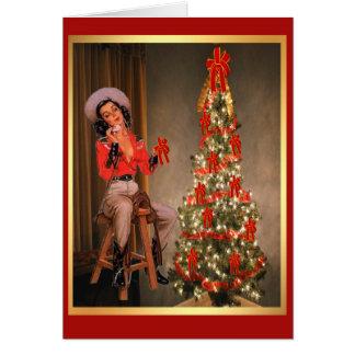 Cartes Cow-girl vintage sur la selle avec l'arbre de Noël