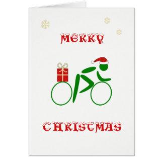 Cartes Cycliste de Noël apportant le cadeau