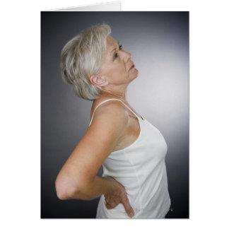Cartes Femme supérieure avec le mal de dos