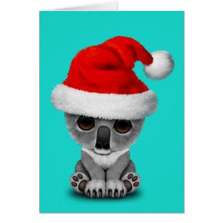 Cartes Koala de bébé utilisant un casquette de Père Noël