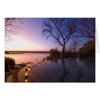 Cartes La loge de club de rivière, coucher du soleil sur