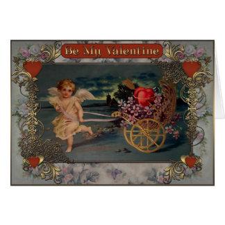 Cartes Le cupidon porte le chariot avec les coeurs et le