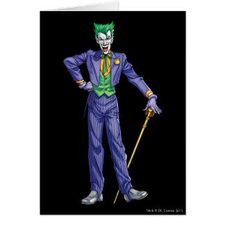 Cartes Le joker se tient avec la canne