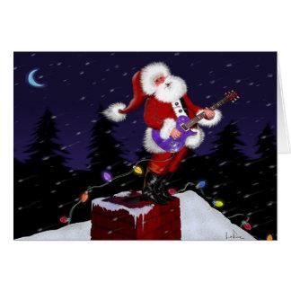 Cartes Le père noël jouant la guitare électrique