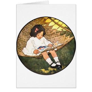 Cartes Lecture de petite fille dans un hamac