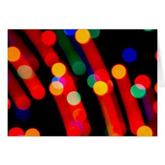 Cartes Les lumières de Noël de Bokeh avec la lumière