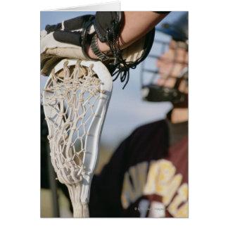 Cartes Main sur un bâton de lacrosse
