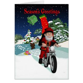 Cartes Moto Père Noël avec des cadeaux de vol et la scène