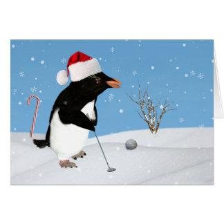 Cartes Noël, pingouin jouant au golf