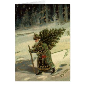 Cartes Noël vintage, le père noël portant un arbre